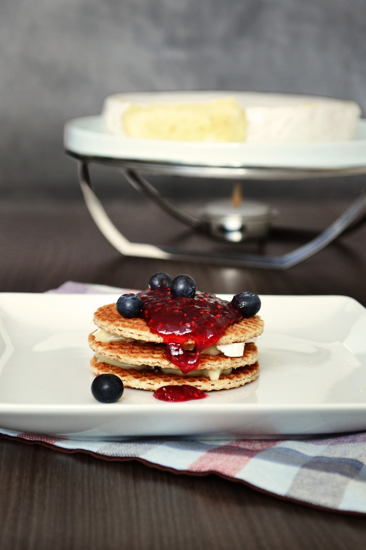 Brie cheese as a filling between layers of Stroopwafel, red fruit jelly and blueberry.