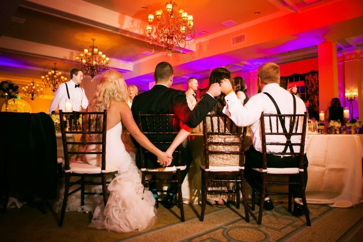 Mjust-have wedding photo ideas: the bride and maid of honor holding hands while the groom and best man fist bump (Limelight Photography)