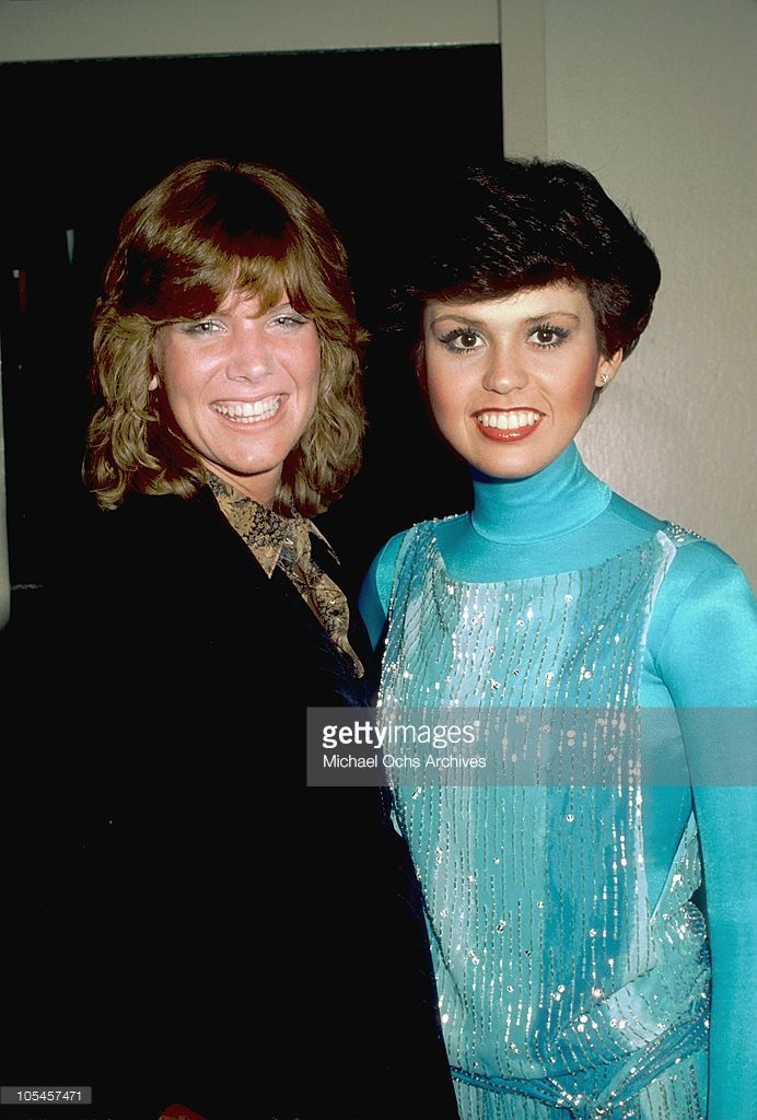 Singers Debby Boone and Marie Osmond pose for a photo backstage at the Donny and Marie Show in May 1978 in Los Angeles, California.