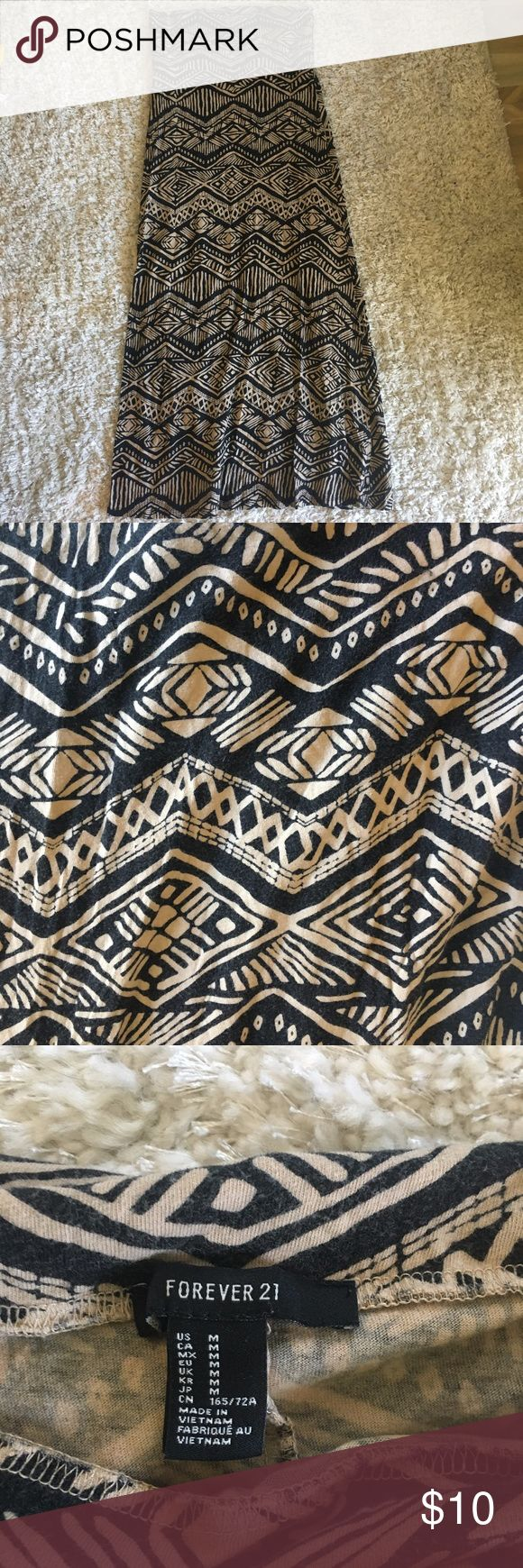 "F21 Black and Tan Tribal Print Maxi Skirt Forever 21 black and tan tribal print cotton maxi skirt with foldover waist  Approximate measurements: waist: 15"" laid flat, 37.5"" long (with waist folded down) Forever 21 Skirts Maxi"