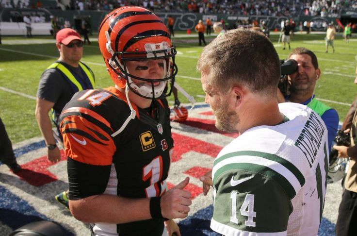 Bengals quarterback Andy Dalton shakes hands with his Jets counterpart Ryan Fitzpatrick after the New York Jets lose 23-22 to the Cincinnati Bengals in NFL action. 9/11/16 East Rutherford, N.J. (John Munson | NJ Advance Media for NJ.com)