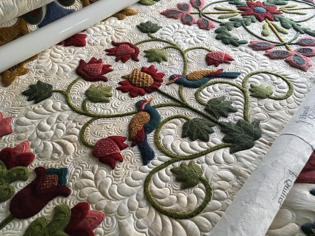 This is the center block on the middle row of my King sized Wool Applique quilt. Adapted from Campania pattern designed by Deidre Bond-Abel. The borders and all the embroidery work are my designs inspired by Deidre's work.