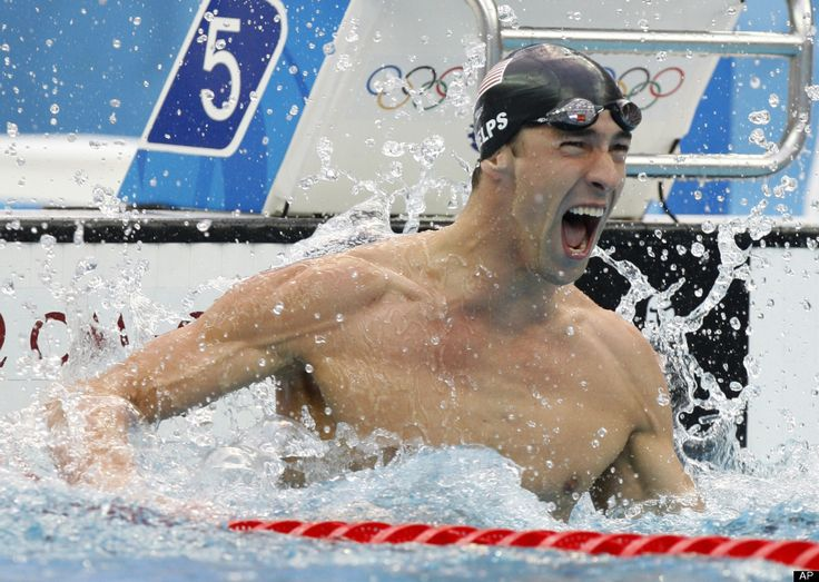 In this Aug. 16, 2004 file photo, Michael Phelps, of the United States, swims in a qualifying heat of the 200-meter butterfly at the Olympic Aquatic Centre during the 2004 Olympic Games in Athens. Phelps retires with twice as many golds as any other Olympian, and his total of 22 medals is easily the best mark. (AP Photo/Mark J. Terrill)