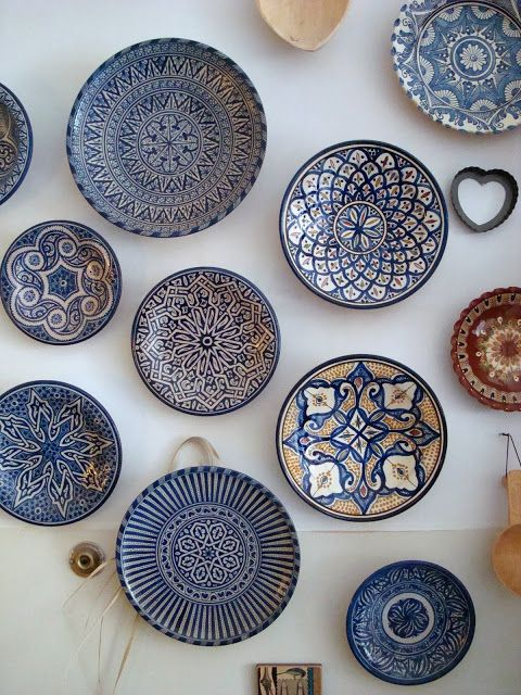 Moroccan Pottery - love all the blue & white plates.