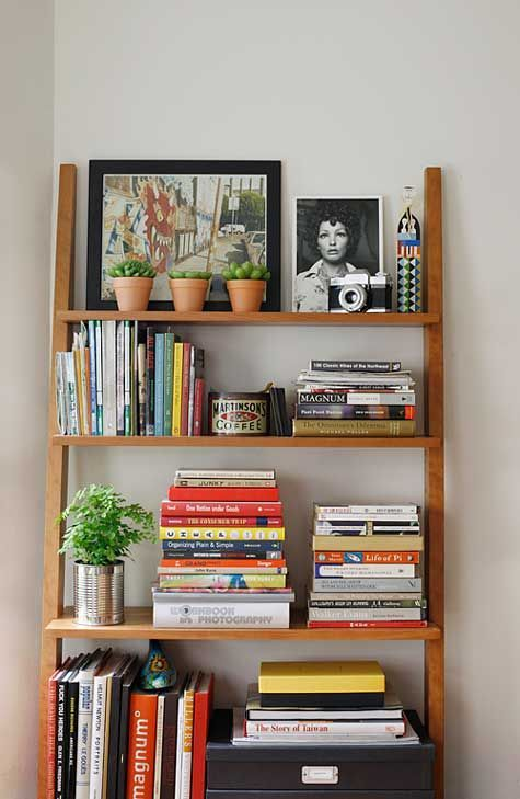 Love this leaning shelf and all that it holds, perfectly distributed. bookshelf styling