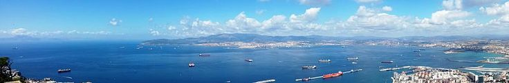 Morocco (top far left across Strait); Spain: Algeciras (top center across Bay of Gibraltar) and La Linea (right); Gibraltar cruise port and airport runway (right foreground); from the Rock