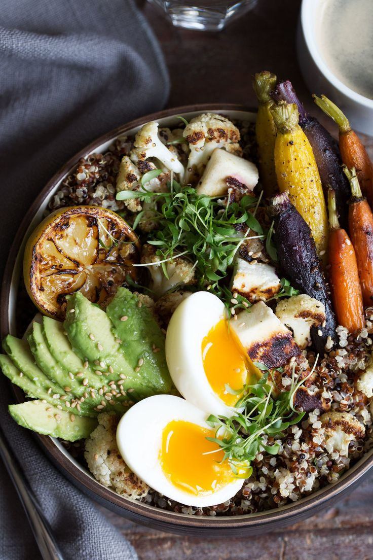 This grain bowl is loaded with quinoa, roasted carrots and cauliflower seasoned with za'atar, soft boiled eggs, halloumi cheese and avocado – all the protein you need to get through the day. Roasted Carrots, Roasted Vegetables, Veggies, Healthy Foods To Eat, Healthy Recipes, Veggie Recipes, Healthy Eats, Free Recipes, Breakfast Bowls