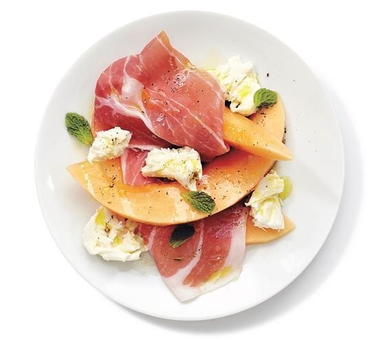 Mozzarella, Prosciutto, and Melon Salad With Mint recipe: Add torn mozzarella to the classic melon-prosciutto combination to create a delicious summer salad.