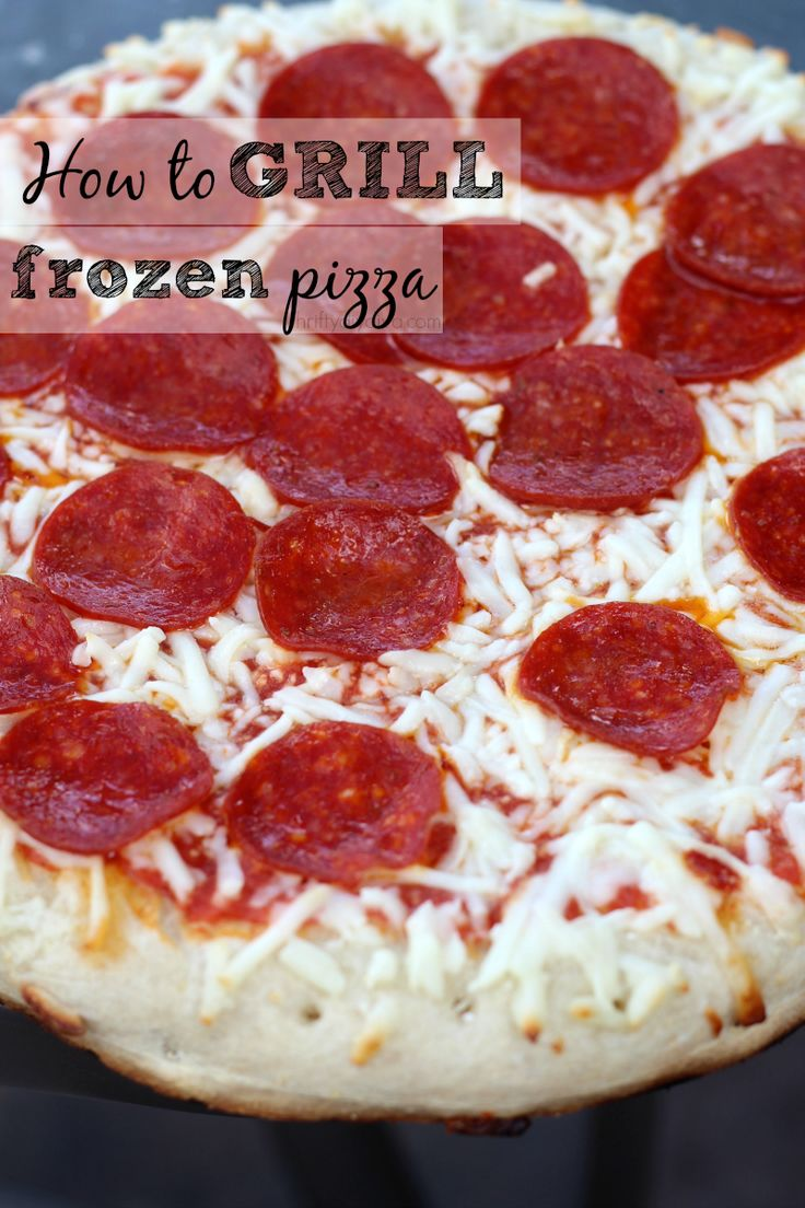 How To Grill Frozen Pizza - perfect for when you don't want to turn the oven on during summer! #grillingtips