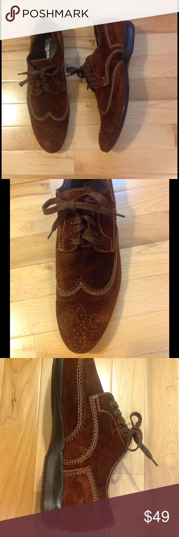 Bacco Bucci men's suede wingtip 11.5 Like new pair of men's casual suede wingtips from Bacco Bucci. The color is a rich tobacco (reddish brown) with contrast stitching - very striking combination. The sole is more like a loafer than a dress shoe so definitely a casual look, but they would really dress up a pair of jeans! Worn only a couple of times and still in excellent condition. Quality materials and craftsmanship that will last a very long time. Really beautiful - would look even better…
