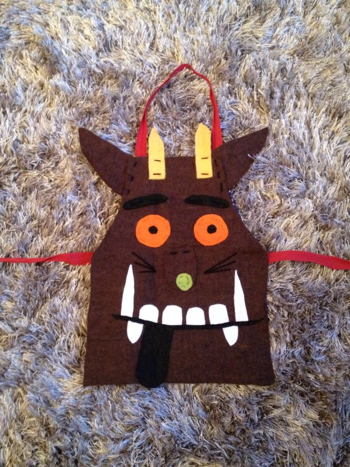 Home made gruffalo costume, made from felt and a child's apron.