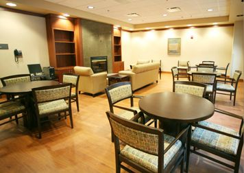 Atrium Medical Center (Middletown, OH) Eloquence side/guest seating with Waveworks round tables in lounge area. #NationalOffice #FurnitureWithPersonality
