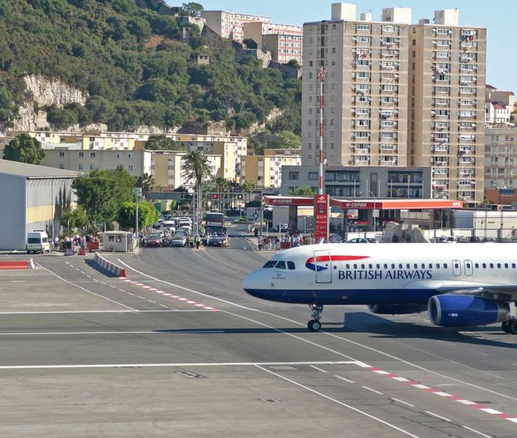 #Gibraltar Airport  Runway crosses the main road which is itself closed for individual operarions.  Aircraft has priority from the left - and the right. lsp