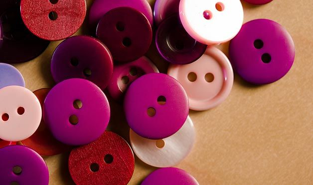 Old Buttons - Re-purpose spare buttons by using them to keep pairs of earrings together: Most buttons have at least two holes in them, so simply place an earring in each opening to neatly store when not wearing.