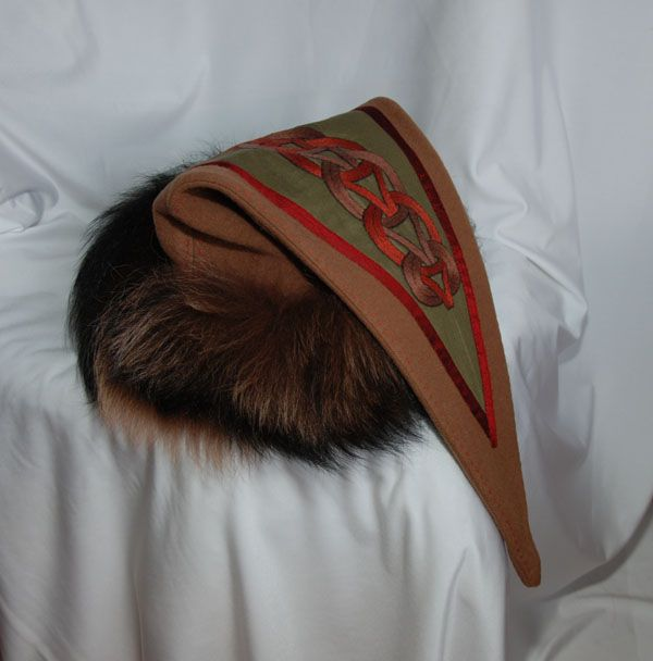 Viking triangle hat with a design from Gosforth. (1 ...