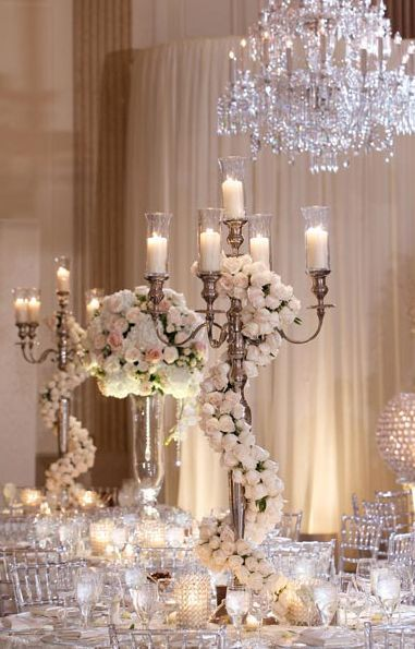 Stunning white floral wedding reception centerpiece; Featured Photographer: Bob & Dawn Davis Photography and Design