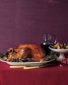 For a beautiful, natural garnish, arrange fresh sage and bay leaves, cracked walnuts, and cranberries around the roasted turkey. Taste the gravy before deciding whether to season with salt.
