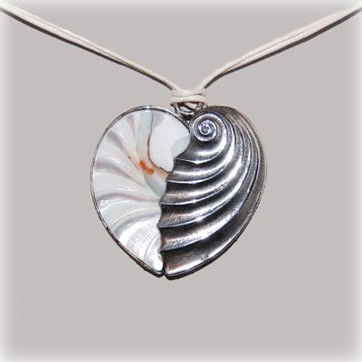 Fantastic double sided nautilus and sterling silver heart. Entirely handmade in our workshop.