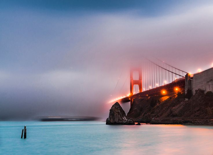 THE LOST GATEWAY (Places) - A huge cargo ship, dwarfed by the Golden Gate, passing under the bridge, amidst dense fog. Fog so dense, that both the ship and the iconic bridge are hidden underneath, as if both are lost. A long exposure created ghosting of the moving ship, adding to the effect. This was photographed after sunset. (Photo and caption by Indranil Mukhopadhyay/National Geographic Photo Contest)