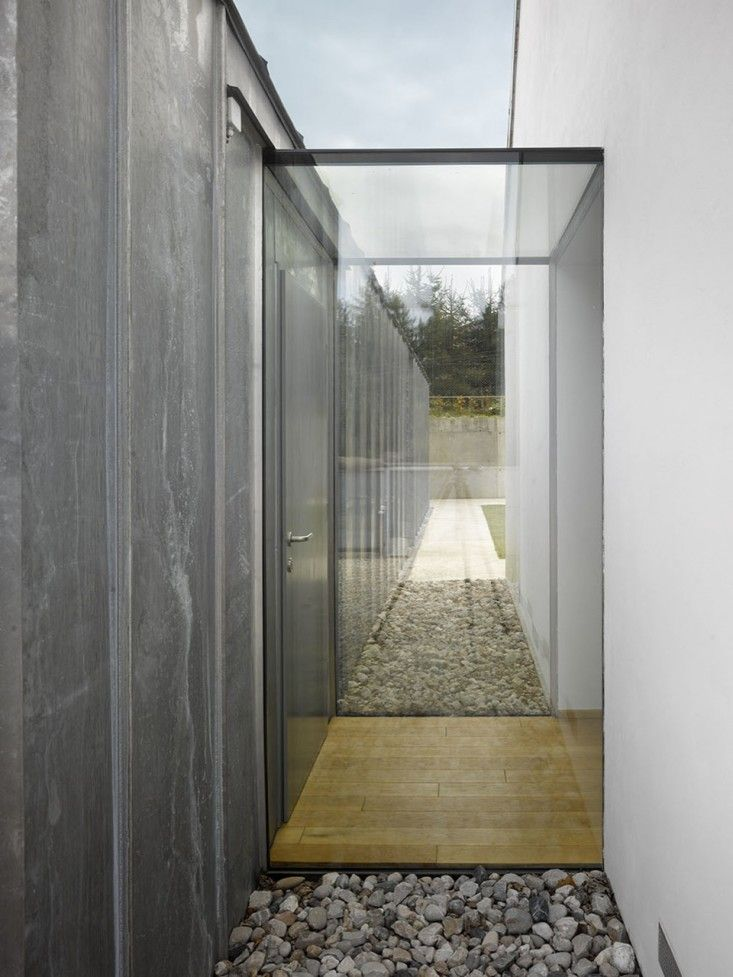 like the glass connection style. minimalistic connector | Remodelista; between the garage and house