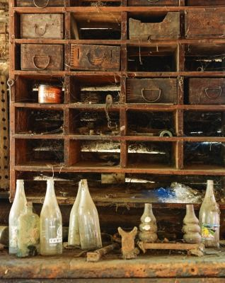 A collection of old bottles on the workshop bench.