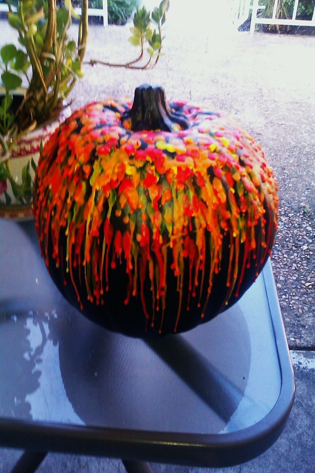"Crayon wax ""Halloween colored"" Pumpkin - done using a hot glue gun...wayyy faster than using a candle lighter!"
