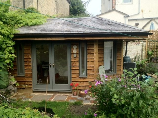 This is the most similar to what we are trying to achieve for the outside look - waney edge boards, tiled roof and coloured UPVC windows/door.