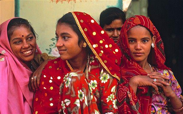 Women wearing colourful Saris Rajasthan India