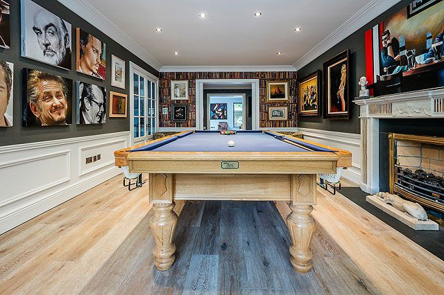 Stylish billiard room in a Dublin home with wood floors from TileStyle. Click the photo to see more of this impressive home...