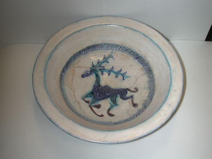 Bowl Syria, :second half 12th century Stonepaste; incised and underglaze painted under transparent colorless glaze (so-called lakabi ware), D. 30.2 cm Met, 29.160.15