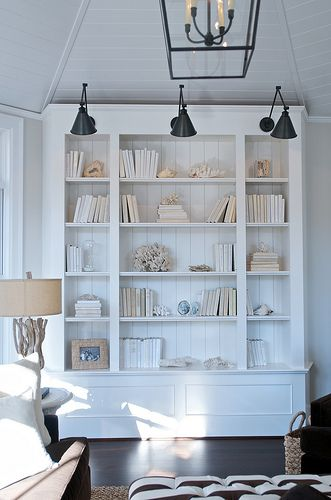 these shelves with the white/cream books and styling.. plus the big black swing arm lamps!? Cool!