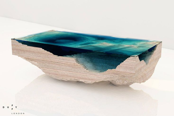 Layered Glass Table creates Oceanic Topography.