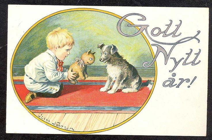 Annons på Tradera: Jenny Nyström. Nyårskort. Gosse ger hunden kattleksak. 1917.