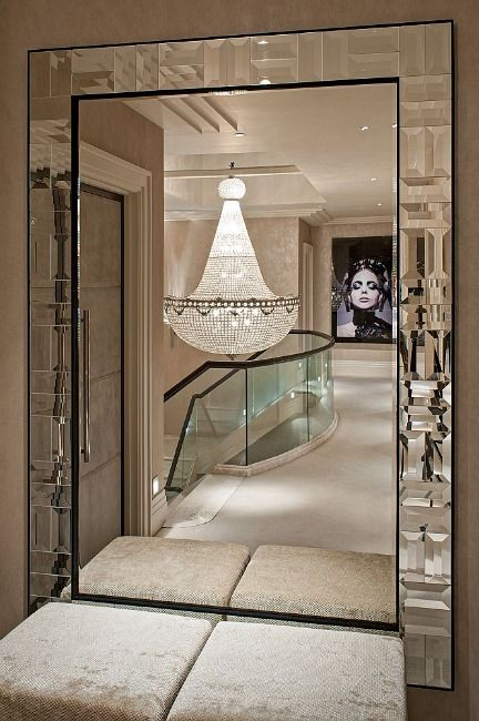 Mirror, glass railing, chandelier...glamorous!