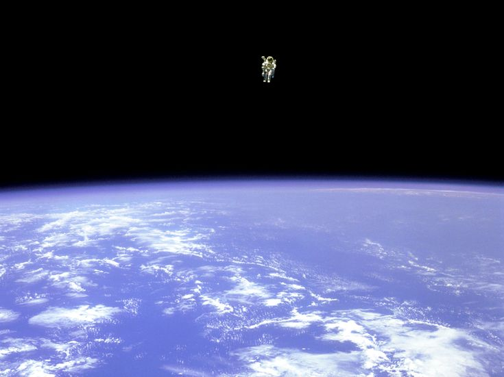 Bruce McCandless II cut a lonely figure over the Earth when he made a record-breaking journey via nitrogen-propelled jetpack in February 1984. He traveled 320 feet away from his spaceship, farther than any previous astronaut.    Photograph by NASA