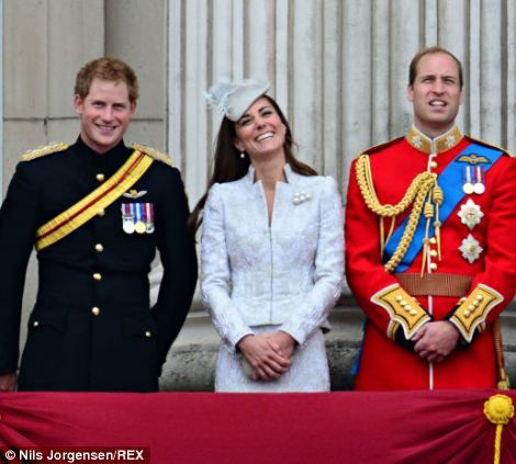 Prince Harry, the Duchess of Cambridge and Prince William watch the flypast at Buckingham Palace. June 14, 2014
