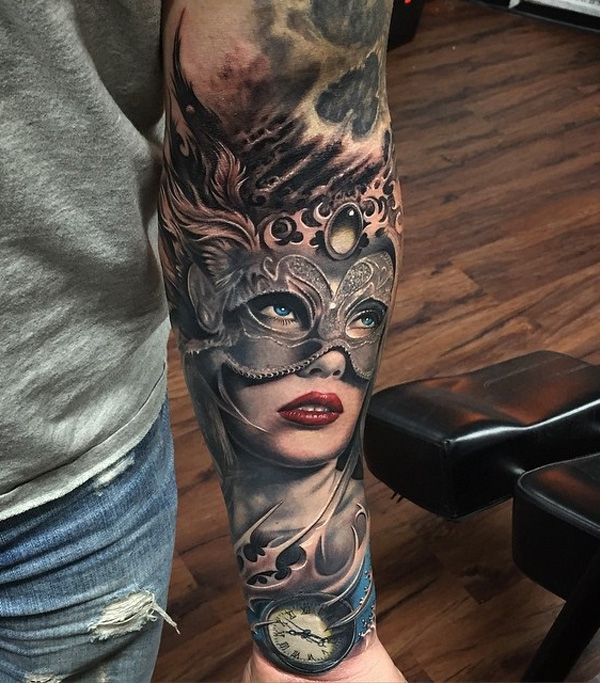 Beautiful masked lady sleeve tattoo. With the great attention to detail as well as the laid back inking of the tattoo makes it look very mystical and enthralling. There is also a pocket watch located below the woman.