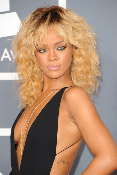 Rihanna looked fabulous as always. Her lightened hair and a very sexy, tight fitting back dress caught every one's eye this year at the 2012 Grammys.