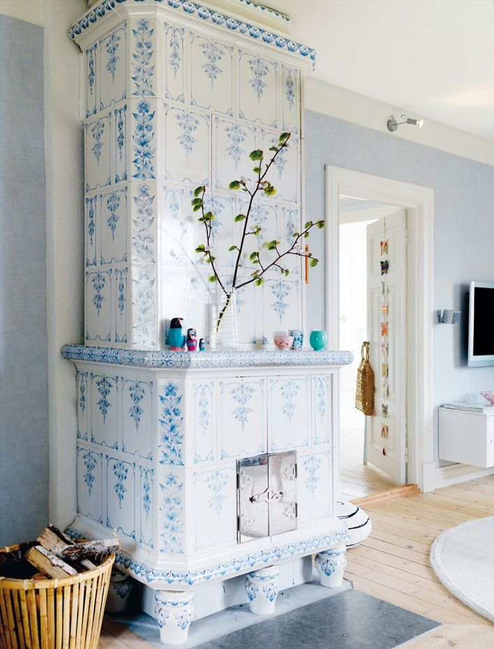 love these swedish tiled wood stoves and chimneys - gorgeous