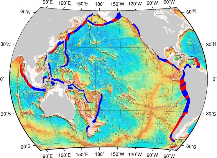 "Map showing subduction zones and oceanic fracture zones. The blue bands are subduction interfaces – the parts of the subduction zone where the subducting plates are physically ""grinding"" against the overriding plates. Colored in red are the areas where oceanic fracture zones intersect these interfaces, which have higher probability of generating great earthquakes. Image: Müller, Landgrebe"
