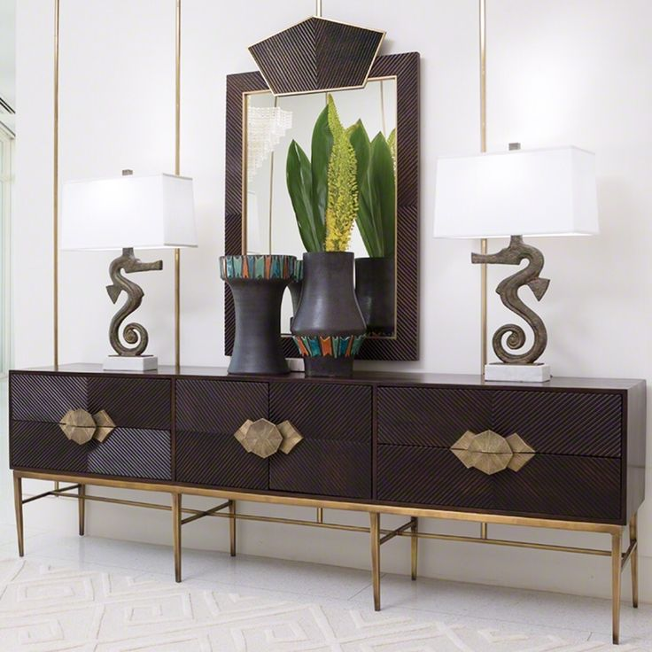 What a lovely display! Gorgeous media cabinet and mirror set, and those seahorse lamps really tie the look together, giving it that tropical beach-vacation feel.