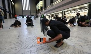 Tate Modern Demonstrators spent 25 hours scrawling messages in charcoal on the floor of the Turbine Hall after a stand-off at the London art gallery