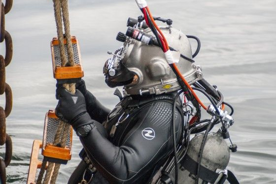 A Coast Guard diver (DV) assigned to Coast Guard Dive Locker West, prepares to exit the water after completing a successful decompression dive off the Coast Guard Cutter George Cobb in the waters off San Pedro, California. U.S. Coast Guard photograph by Petty Officer 1st Class Andrea L. Anderson.