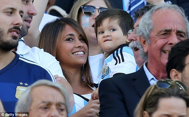 Big fans: Messi's girlfriend, Antonella Roccuzzo, and their son Thiago watched Argentina's...
