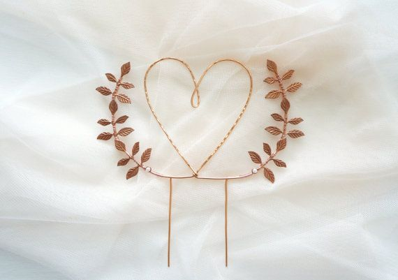 Lovely heart cake topper. *Shaped and hammered by hand. *Rose gold/copper leaves arch, wired by hand. *About 5.25 inches at its widest point. *Expect slight variations due to handmade nature. *Easy to use and re-use. *The leaves and the wiring are slightly different tones.   Simply plunk it on the cake or pie for instant prettiness! :) See more wedding accessories and details here: www.lietofiore.etsy.com