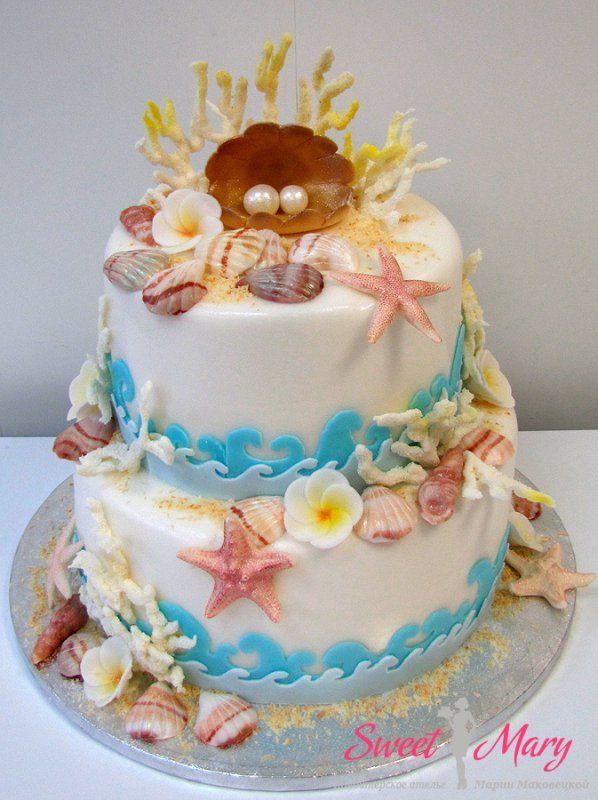 Торт на юбилей - жемчужную свадьбу - выполнен в теме свадебного торжества. Морской торт украшен ракушками, морскими звездами, кораллами. А вместо традиционных фигурок жениха и невесты торт с морском стиле венчает раковина с двумя жемчужинами.   http://sweetmary.ru/cakes-order/svadebnye/1027-tort-na-zhemchuzhnuju-svadbu.html