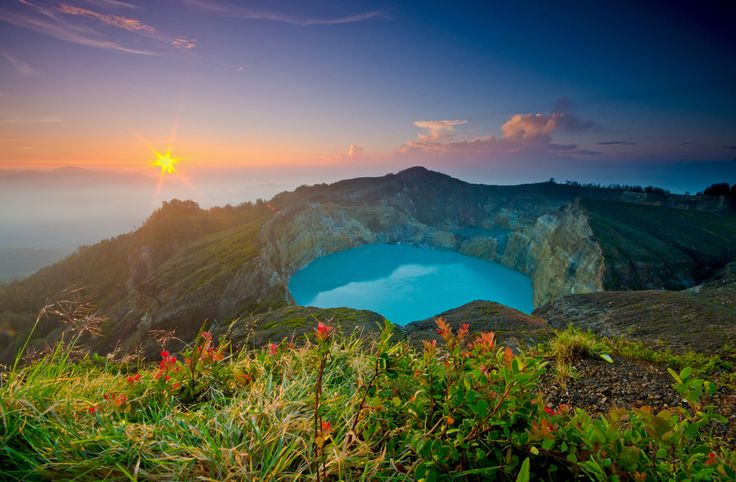 Shot taken at sunrise over the surreal lakes of Kelimutu volcano, in central Flores Island of Indonesia.By Alika