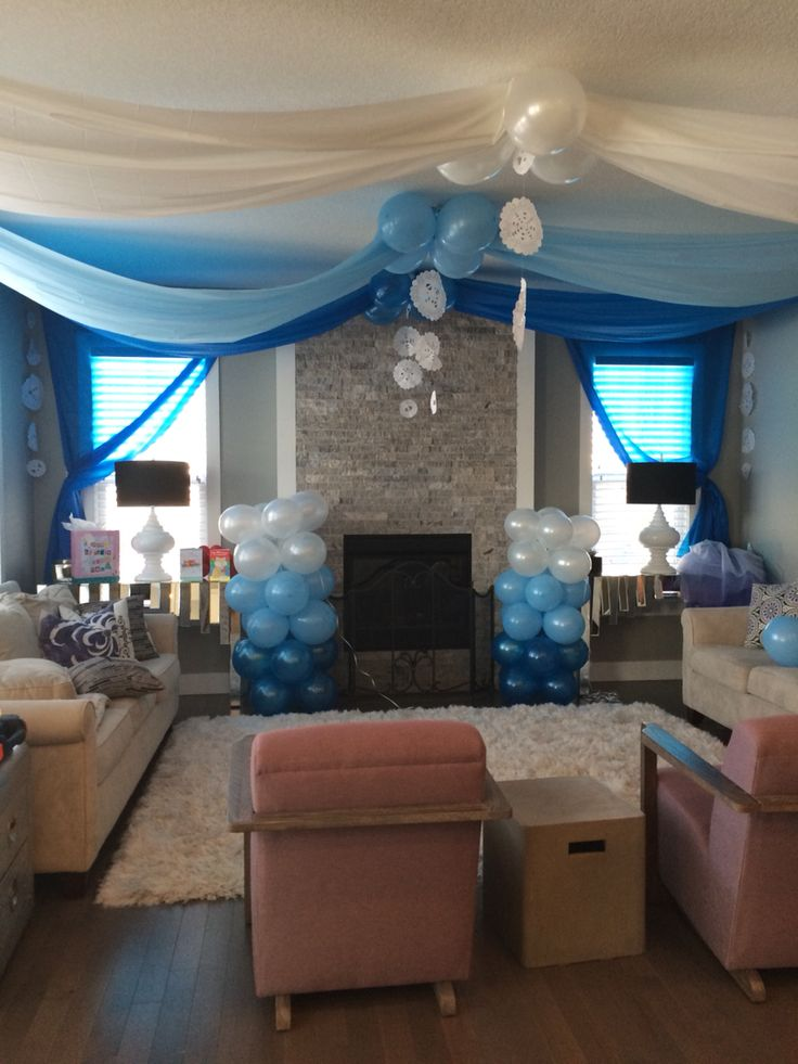 Frozen Birthday Party Decor!  DIY Ice Castle complete with balloon towers, and paper doily snow flakes