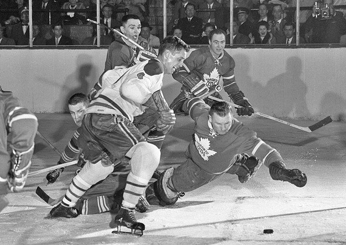 This archival photo of the Maple Leafs and the Montreal Canadiens (Jean…