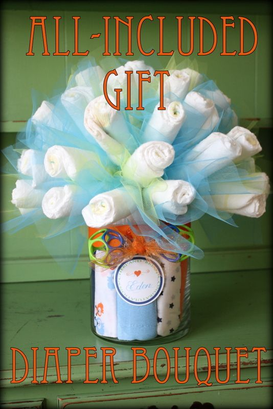 "Like Mom and Apple Pie: Baby Shower Gift-Diaper Bouquet DIY and Tutorial- burp cloths in vase and rattle for the ""bow"""